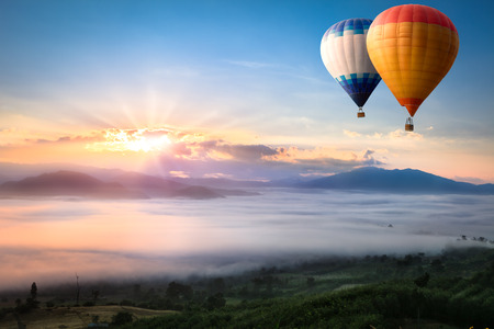hot air balloons: Hot air balloon over sea of mist