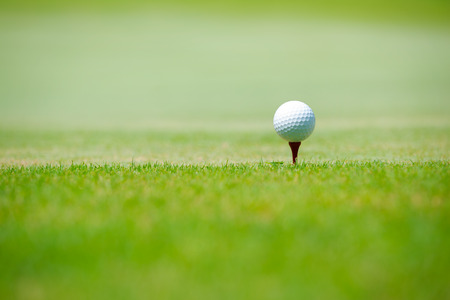 golf clubs: Golf ball on green grass