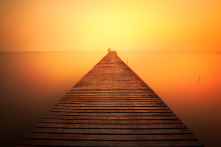 Wooded bridge at sunset Stock Photo