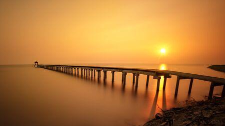 Wooded bridge at sunset photo