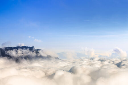 over the hill: Mountains above clouds