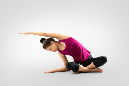 adult mermaid: Young asian woman doing yoga, Isolated on grey background