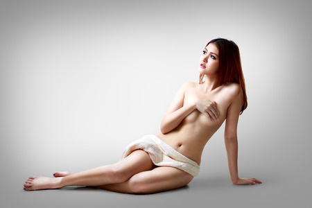sexy nude girl: Sexy asian woman sitting on the floor, Isolated on grey background