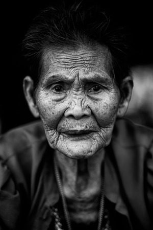 Close up face of old asian woman with wrinkles elderly senior