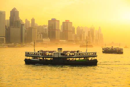 hong: Hong kong ferry in the bay at sunset Stock Photo