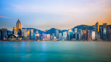 victoria: Hong Kong skyline in the evening over Victoria Harbour Stock Photo
