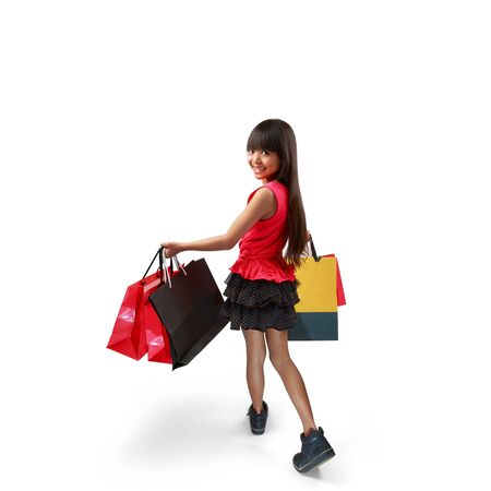 asian girl shopping: Little asian girl with shopping bags, Isolated over white Stock Photo