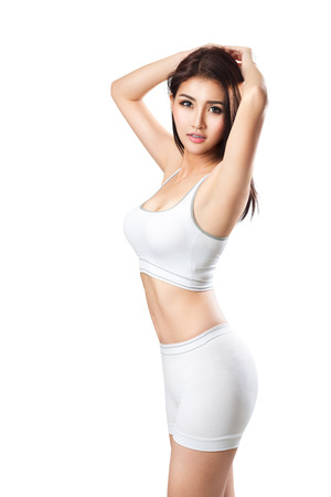 Closeup young asian sporty woman, Isolated over white Stock fotó