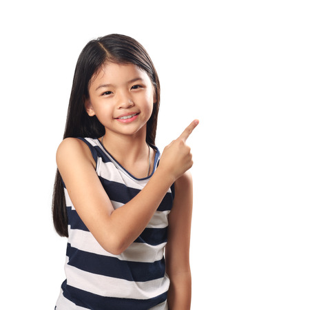 thai teen: Cute little girl with index finger up Isolated over white Stock Photo