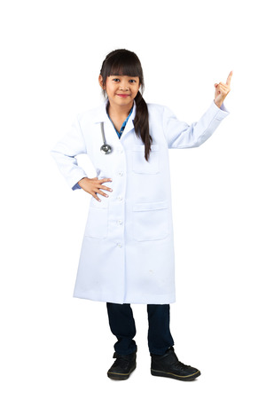 kid at doctor: Little doctor, Cute little asian girl dressed like a doctor and pointing to something, Isolated over white