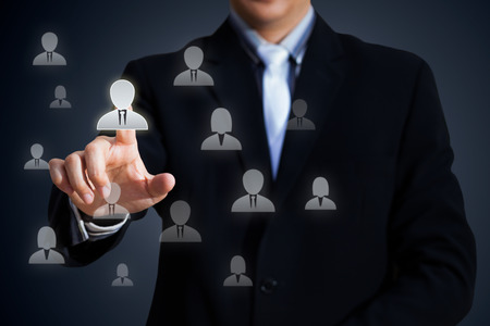 chief executive officers: Human resources officer choose employee standing out of the crowd, Select team leader concept