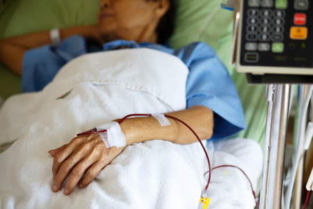 patient in bed: Closeup patients hand show blood transfusion in hostpital