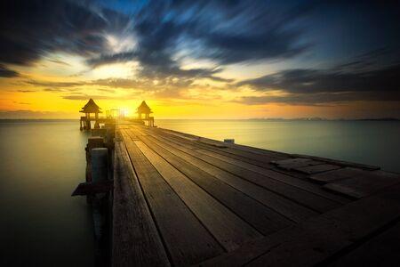 over: Wooded bridge at sunset Stock Photo