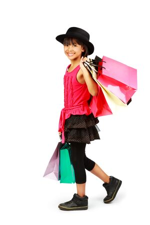 happy shopping: Little asian girl with shopping bags, Isolated over white Stock Photo