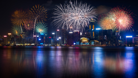 fireworks display: Night view and fireworks at victoria harbour, Hong Kong Stock Photo