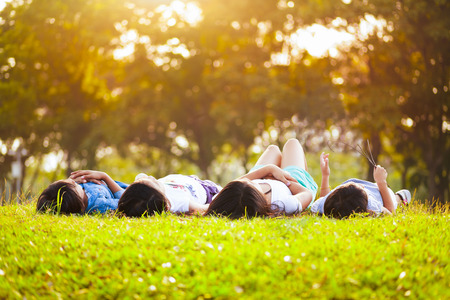 asian natural: Children laying on grass in park