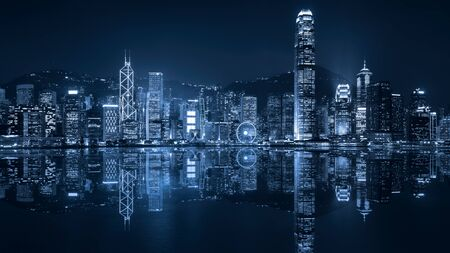 duo tone: Victoria harbour skyline at night in Hong Kong