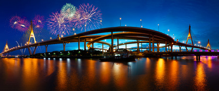 night view: Bhumibol bridge at night with fireworks, Bangkok Thailand