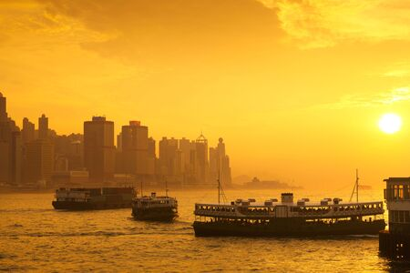 ferries: Star ferry passenger boats at sunset in victoria harbour, Hong kong