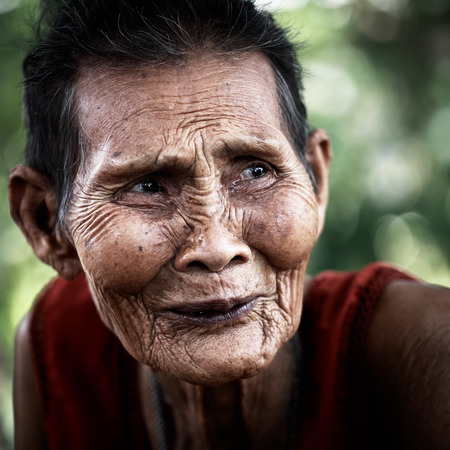 old asian: Close up face of old asian woman with wrinkles elderly senior