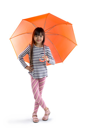 umbrella: Little asian girl with umbrella, Isolated on grey background