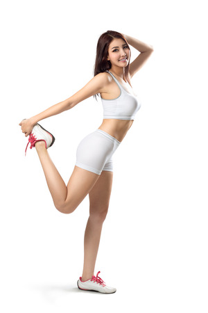Fitness woman stretching full body, Isolated over white Фото со стока - 44191483