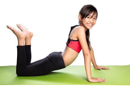Little asian girl doing fitness exercises, Isolated over white Foto de archivo