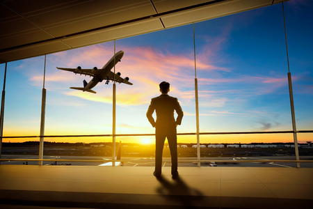 Businessman standing in airport Stock Photo
