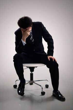 depressive: Young business man depressive, Isolated on grey background