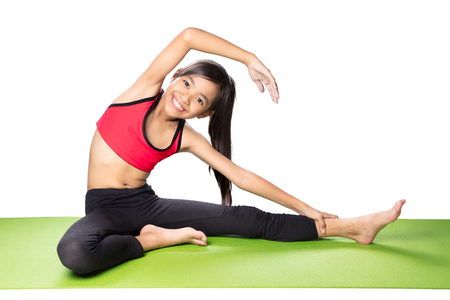 kids activities: Little asian girl doing fitness exercises, Isolated over white Stock Photo
