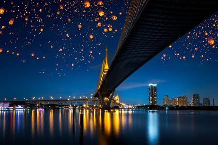 stars night: Floating lantern over bridge at night