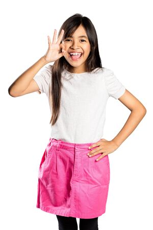 all ok: Happy smiling young asian girl with OK hand sign, Isolated over white