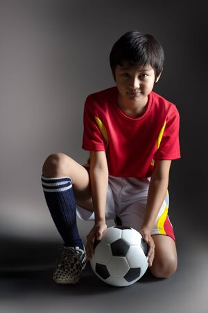 thai culture: Portrait of young boy with a soccer ball