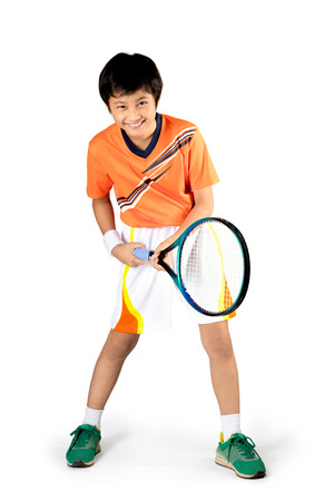 male tennis players: Young boy playing tennis, Isolated over white