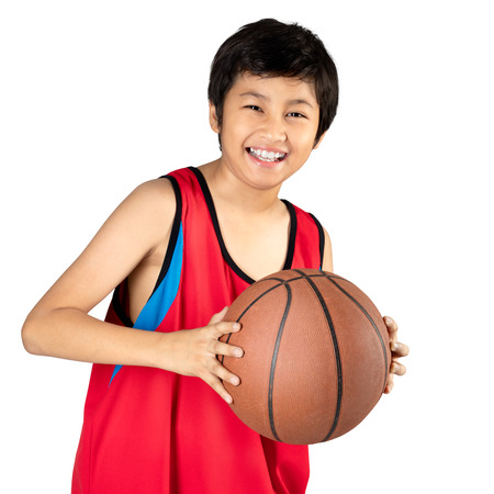 Adorable child playing the basketball, Isolated over white Standard-Bild