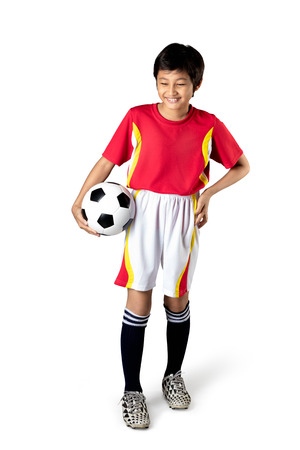 asian boy: Cute asian boy is holding a soccer ball, Isolated over white