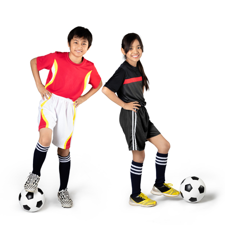 futsal: Young asian children playing soccer, Isolated over white