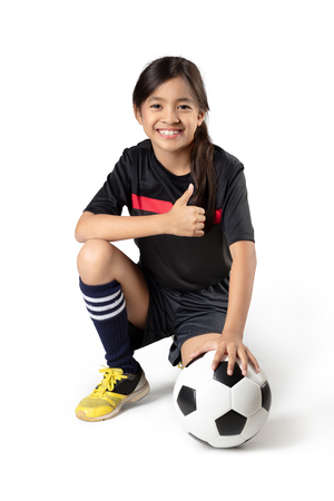 Young asian girl holding soccer ball, Isolated over white Stok Fotoğraf - 47388214