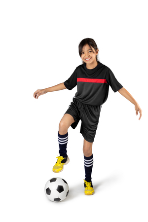 Young asian girl playing soccer, Isolated over white