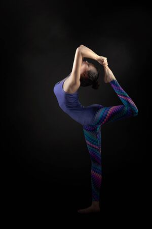 thai stretch: Young asian woman doing yoga