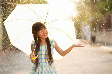 rain weather: Pretty young asian girl in the rain with umbrella Stock Photo