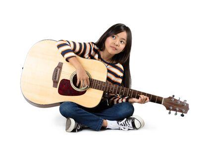 accoustic: Young asian girl with a accoustic guitar, Isolated over white