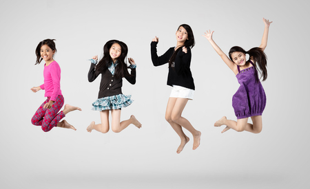 Group of children jumping, Isolated on grey background