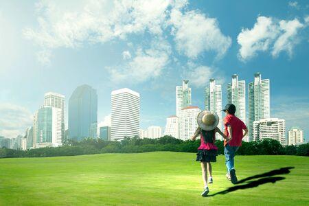 asia children: Happy children running in the city park