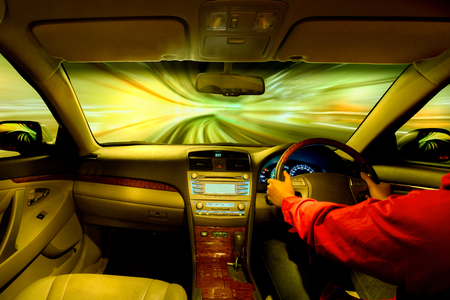 inside car: Night road view from inside car natural light street and other cars is motion blurred