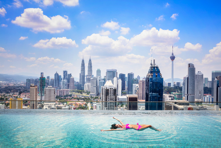 bay: Swimming pool on roof top with beautiful city view kuala lumpur malaysia Stock Photo