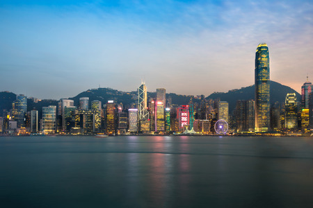 harbour: Hong Kong skyline in the evening over Victoria Harbour Stock Photo