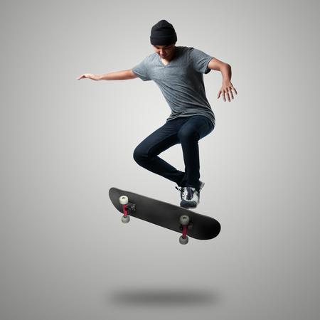 Skateboarder on a high jump Foto de archivo