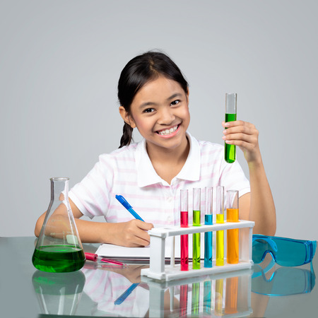 Little asian girl is making science experiments education 스톡 콘텐츠