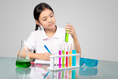 Little asian girl is making science experiments education Stock fotó